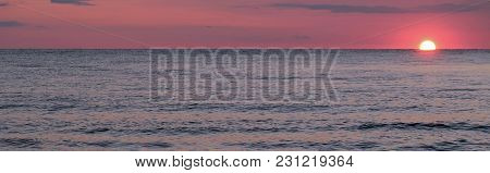 The Sun Setting Below The Horizon Casts A Brilliant Red Glow In The Sky At Lake Michigan. St. Joseph