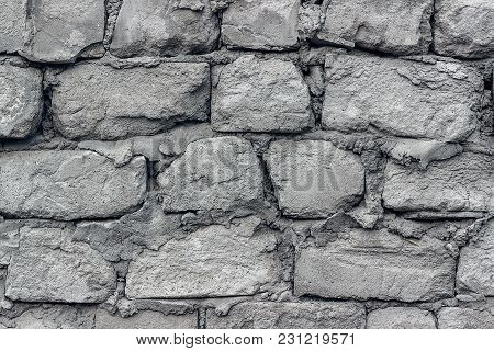 Gray Old Wall Made Of Aerated Concrete Blocks, Close Up. Texture, Background.