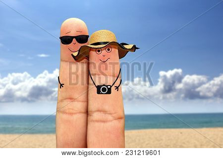 Happy Finger Couple Face On Vacation At The Beach