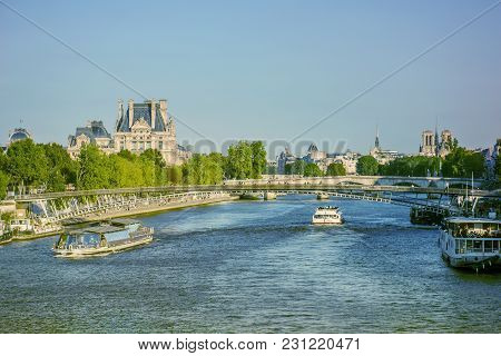 View Of The Senna River In Paris, France. Boats, Bridges And Buildings.