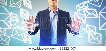 Businessman touching the invisible screen against abstract blue background