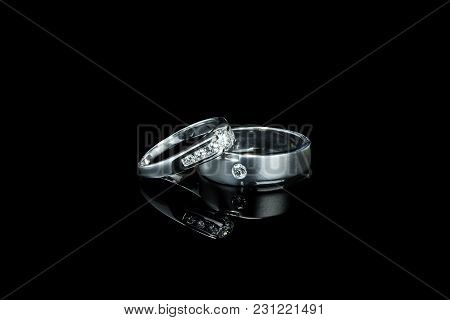 Couple Of Luxury Wedding Diamond Rings For Bride And Groom Isolated On Black Background With Shadow