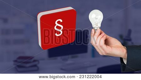 Digital composite of Hand holding light bulb and section symbol icon