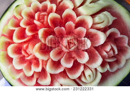 A Watermelon Is Craved In Pattern Of Flower.