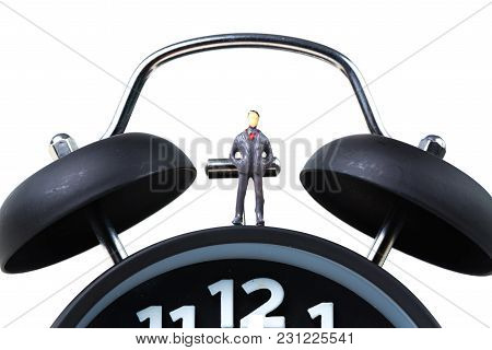 Figure Miniature Businessman Or Small People Standing With Alarm Clock, Time For Business Financial