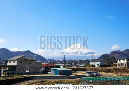 Kawaguchiko , Japan - March  26, 2018 : Mt. Fuji Is The Largest Mountain In Japan, Visible From A Di