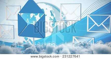 At e-mail symbol against global business graphic in blue