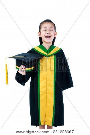 Kindergarten Graduation. Happy Asian Child In Graduation Gown Holding Cap At Studio. Cute Girl Smili