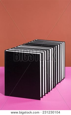 Stack Of Books On A Colored Background