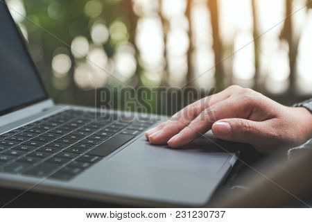 Closeup Image Of Hands Working , Touching And Typing On Laptop Keyboard With Blur Nature Background