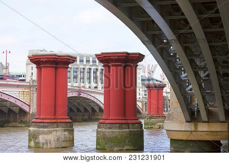 Blackfriars Railway Bridge On The River Thames,old Red Columns, London, United Kingdom