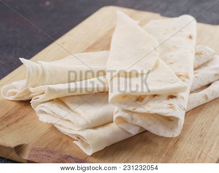 Armenian Flat Bread Lavash. Pita Bread On Wooden Cutting Board. Copy Space.