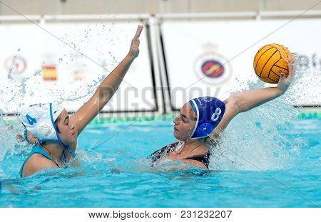 BARCELONA, SPAIN - FEB, 17: Mireia Guiralt(L) of CN S. Andreu vies with Maica Garcia(R) of CN Sabadell during a Copa Reina match at the J. Valles Swimming Pool on February 17, 2018 in Barcelona, Spain
