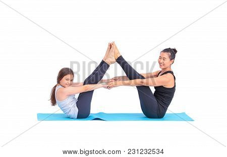 Female Teacher Training A Little Girl, Practicing Yoga Class