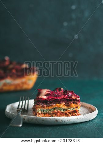 Vegetable Packed Rainbow Lasagne On Green Background.ideas And Recipes For Healthy Vegetarian Dinner