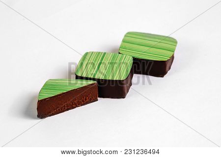 Cut Handmade Chocolate Candy With  Filling Isolated On White