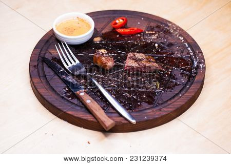 Close up of meat after eating steak on the white dish