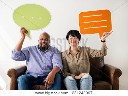 Couple holding message boxes