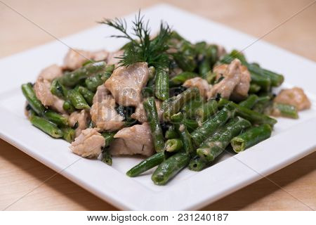 Restaurant dish - roast from turkey and string beans