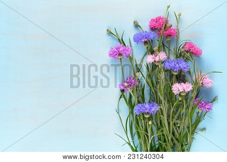 Bunch Of Cornflowers On Blue Wooden Background