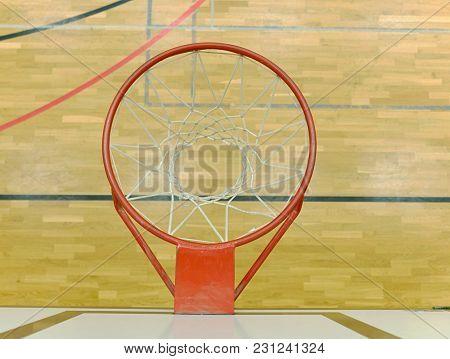 View From Up Through  Basketball Hoop, School Sporting Wooden Board At The Bottom  With A Black Line