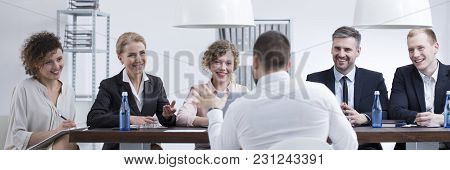 Smiling Recruiters Listening To Man