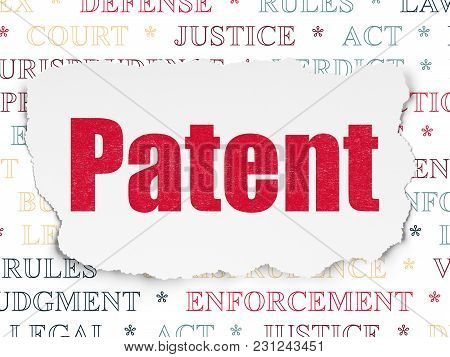 Law Concept: Painted Red Text Patent On Torn Paper Background With  Tag Cloud
