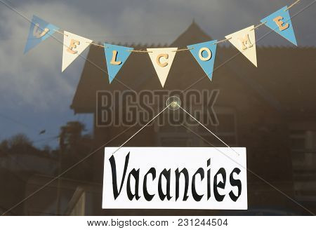 Welcome And Vacancies Sign In Shop Window