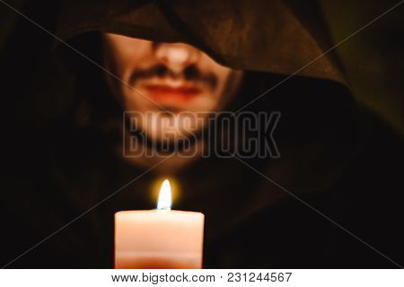 The Monk In The Dark Over The Candle Idly By