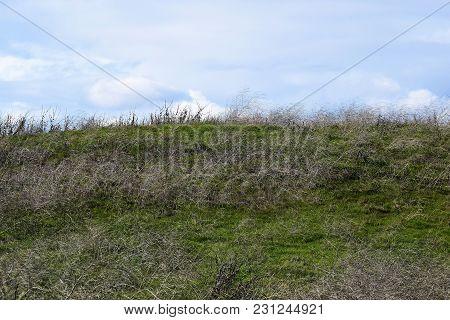 Barren Rural Grasslands On A Forgotten Desolate Landscape