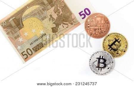 Financial Concept With Image Of Bitcoins On Fifty Euro Banknote. Traditional Money Versus Cryptocurr