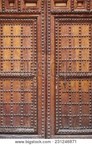 Antique Wooden Door With Iron Inlays. Arquitecture Background. Vertical