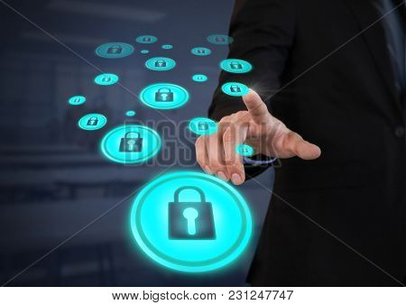 Digital composite of Businessperson touching security lock icons