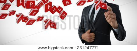 Mid section of businessman pointing against bit coin symbol