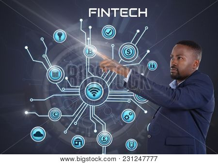 Digital composite of Businessman touching with various business icons interface