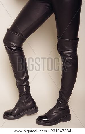 Slim Women's Legs In Black Leather Pants And Stylish High Boots