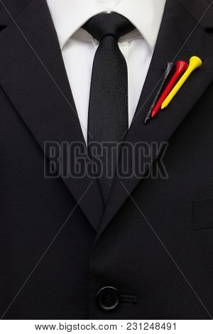 The Detail Of Wedding Suit With Golf Design.golf Tees In The Color Of German Flag On The Flap Of Bla