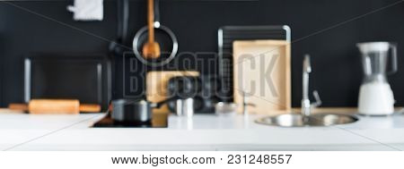 Defocused View Of Cooking Accessories Kitchen Black Wooden Panel Dishes Table Ware Different Support