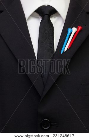 The Detail Of Wedding Suit With Golf Design.golf Tees In The Color Of Usa Flag On The Flap Of Black