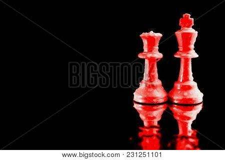 Close-up Of The King Of Chess And Red Queen Used As A Symbolic Leader In Business. On A Black Backgr