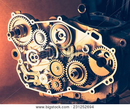 disassembled engine of motorcycle with gear cogwheels, close-up view