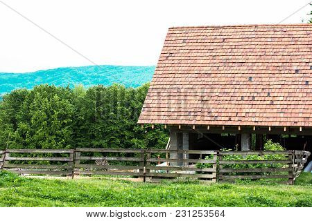 Barn, House For Animals, Barn Against The Backdrop Of Mountains.