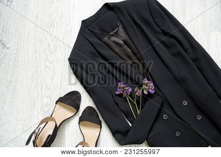 Black Jacket, Shoes And Wild Flowers. Fashionable Concept