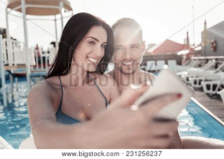 Say Cheese. Joyful Young Woman And Man Grinning Broadly While Posing Together For A Self Portrait Pi