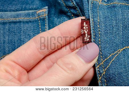 Kharkov, Ukraine - 02 March 2018: Label Levis On Jeans In Female Hand