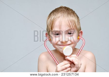 Cute Boy With Toy Phonendoscope Playing Doctor. Portrait