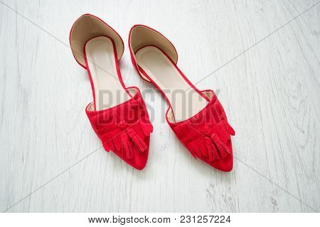 Red Open Shoes On A Light Wooden Background. Top View