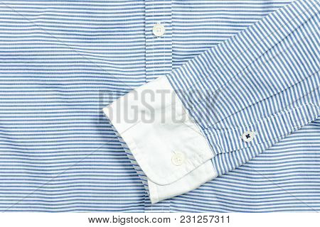 Sleeve Of Blue And White Striped Shirt. Detail.