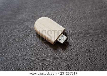 Usb Flash Drive With Wooden Surface On Desk For Usb Port Plug-in Computer Laptop For Transfer Data A