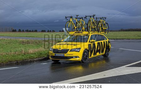 Cernay-la-ville, France - March 5, 2017: The Yellow Technical Mavic Car Driving On A Wet Road During